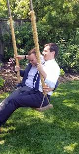 Image result for pete buttigieg and husband on a swing